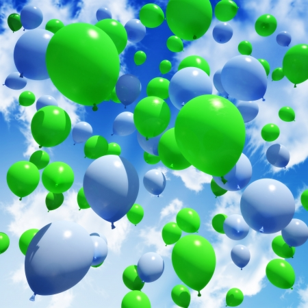 Blue and green Balloon s released into the sky 版權商用圖片