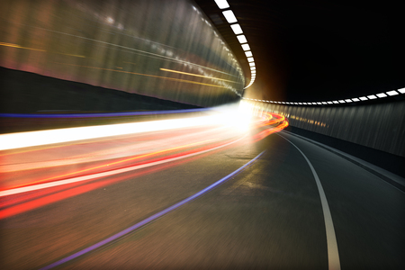 light zoom: Light tunnel, Vehicle light trails in a tunnel Stock Photo