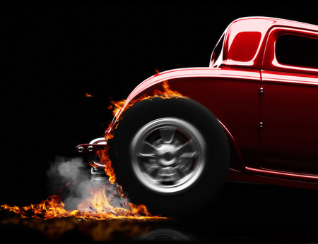 Hot rod burnout on a black background with room for text or copy space 版權商用圖片