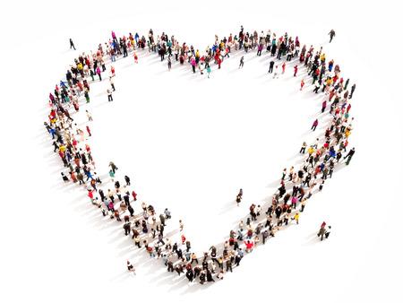 白い背景の上の心の高角度のビューの形で人々 の大きいグループ 写真素材