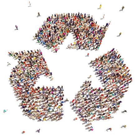 reciclar: Las personas que reciclan Gran grupo de personas en la forma de un s�mbolo de reciclaje que apoyan el cambio ambiental Foto de archivo