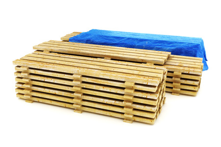 2x4: Stacks of wood building lumber on a white background