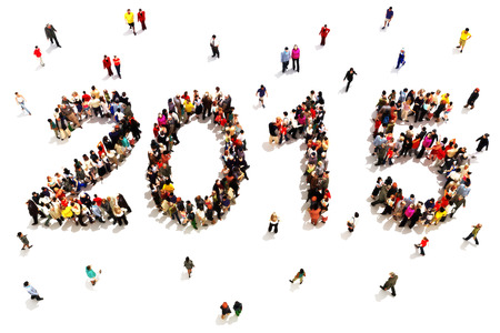 Bringing in the new year. Large group of people in the shape of 2015 celebrating a new year concept on a white background.