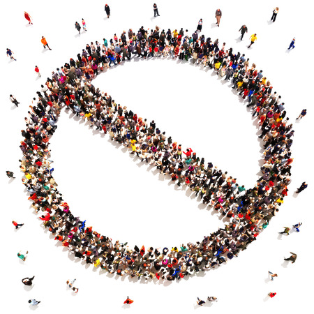rejection: People that say no, prohibited, rejection,  or no support concept. Large group of people in the shape of a no sign with room for text or copy space Stock Photo