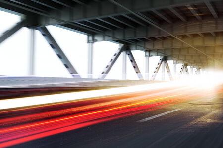 Vehicle light trails on a modern bridge. Photo realistic 3d model scene Archivio Fotografico