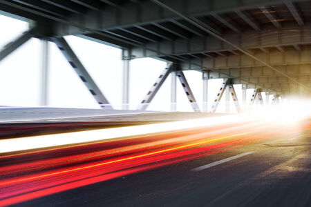 light trails: Vehicle light trails on a modern bridge. Photo realistic 3d model scene Stock Photo