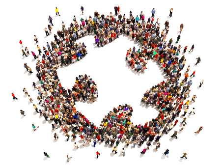 People putting the pieces together concept . Large group of people forming the shape of a puzzle   piece with room for text or copy space on a white background.