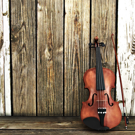 fiddles: A Violin leaning on a wooden fence. Advertisement with room for text or copy space Stock Photo