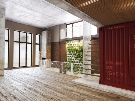 Empty room of residence with an atrium against the back wall and hardwood floors. 報道画像