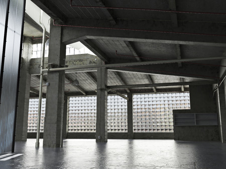 Large Interior grunge framed warehouse with an empty floor. Banco de Imagens