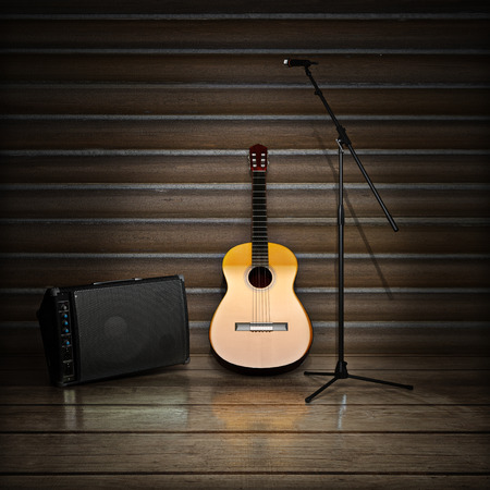 amp: Music themed background with acoustic guitar , amp and microphone.
