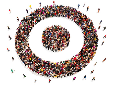 focus on: People on target with there goals and carrier choices concept. Large group of people in the shape of a target symbol. Stock Photo