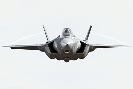 view from the plane: F35 front view close up flying to the camera with chem trails Stock Photo