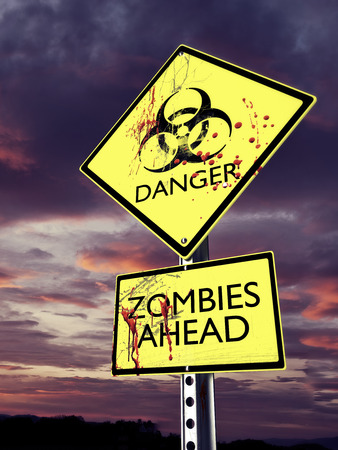 danger ahead: Danger Zombies ahead weathered bio hazard warning sign with blood. Stock Photo