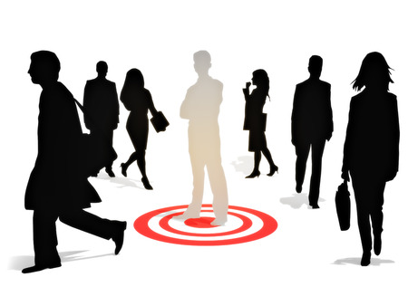 targeted: Targeting perfection .Business man standing on a target among a group of competitors isolated on a white background. Focusing on strategy,goals or success concept.