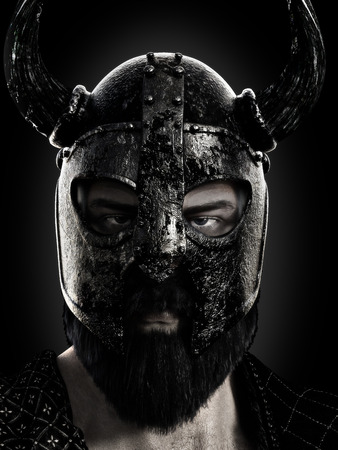 Viking close up wearing a helmet in black and white