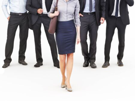 way: Image of a group of young businessmen standing with a businesswoman walking in front. Leading the way, diversity or harassment concept. Photo realistic 3d model scene.