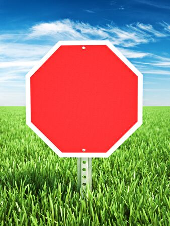room for text: Red stop themed sign placed in a field of grass with room for text or copy space. Photo realistic 3d rendering Stock Photo