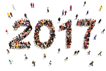 Het brengen in het nieuwe jaar. Grote groep mensen in de vorm van 2017 vieren van een nieuw jaar concept op een witte achtergrond.