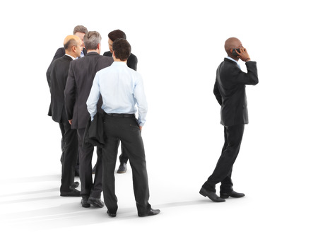 leading: Group of business men with one emerging to the front. Leading the pack, leadership ,performance,initiative or minority concept on a white isolated background. 3d rendering Stock Photo