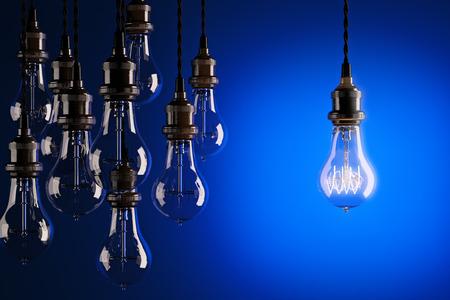 edison: Decorative antique edison style light bulbs against a blue background. 3d render