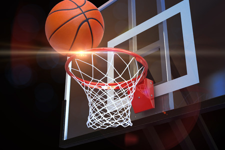 international basketball: Basketball heading to the net at a sports arena with lens flare . Sports, fitness , competition team concept. 3d rendering