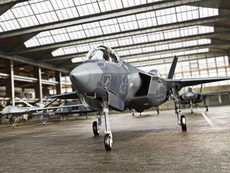 Military aviation arsenal inside a military hangar awaiting deployment. F 35 Fighter jet, stealth fighter and attack drone. 3d rendering Archivio Fotografico