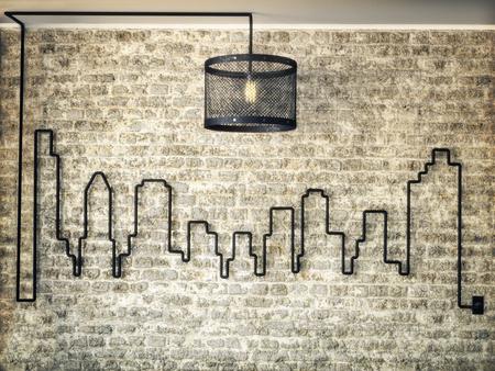 Le kit de lumière rustique a accablé le mur d'un horizon de la ville sur un fond de mur de briques. Illustration de rendu 3D.