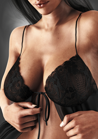 Sexy female with natural breasts teasing the removal of her lingerie . 3d rendering Lizenzfreie Bilder