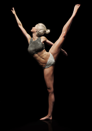 Athletic female posing with a black background. Symbolism of strength , power and beauty  . 3d rendering 版權商用圖片