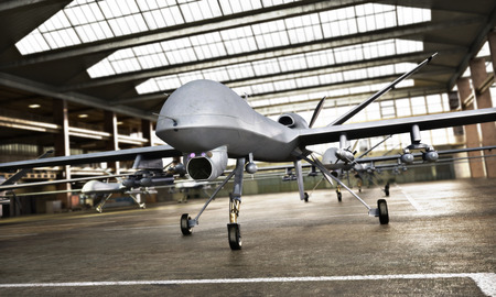 Military Drone UAV aircrafts with ordinance in position in a hangar awaiting a strike mission. 3d rendering