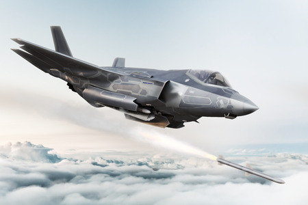F-35 Advanced military aircraft locking on target and firing Missile's . 3d rendering Foto de archivo