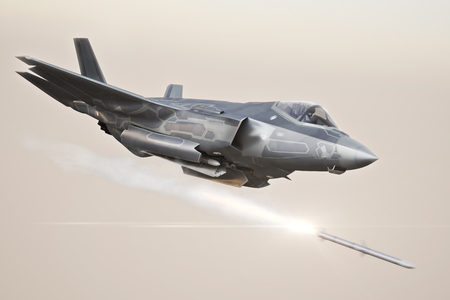 F-35 Advanced military aircraft locking on target and firing Missiles . 3d rendering Stock Photo