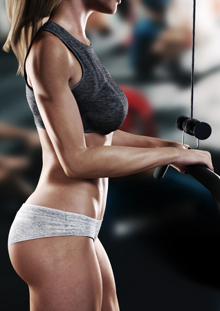 Fit female working out at the gym. 3d rendering Stock Photo