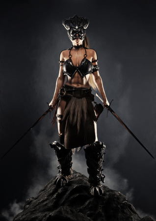 Portrait of a fierce armed female warrior posing with two swords on a rock outcrop with a black background. 3d rendering illustration