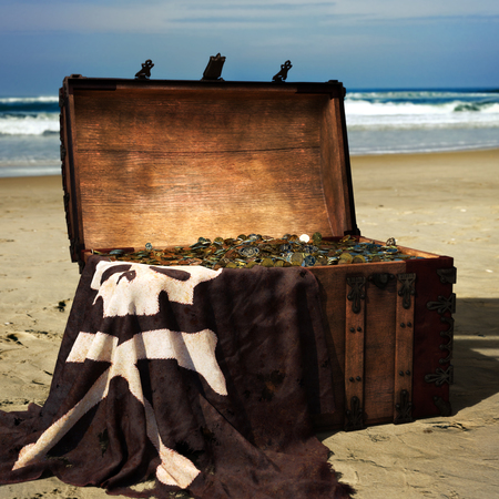 Pirate chest on the beach filled with gold coins . 3d rendering Zdjęcie Seryjne