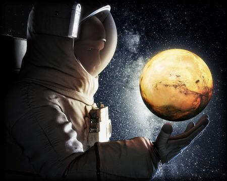 Dreaming of Mars. Astronaut reaching for the red planet of Mars. Exploration and journey to Mars concept. 3d rendering .Elements of this image furnished by NASA