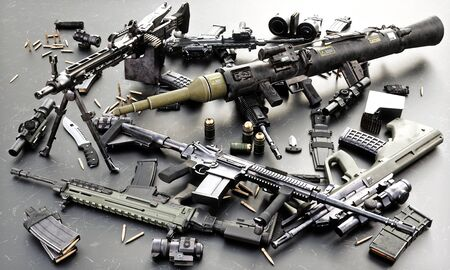 Weapons stash of military grade weapons with automatic assault rifles , RPG and accessories. 3d rendering Фото со стока