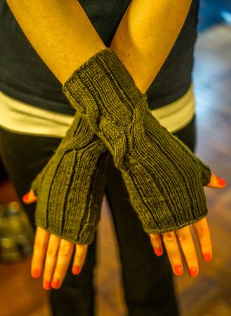Wearing knit fingerless gloves