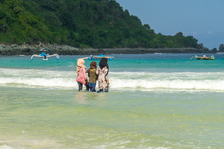 Learning to surf on Selong Belanak Beach Stock Photo