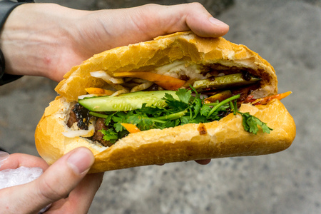 getting banh mi in Vietnam Stock Photo