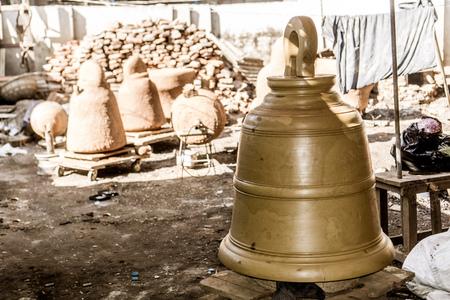 Mandalay, Myanmar - large buddhist bell brass casting