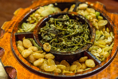 Mandalay, Myanmar - burmese food - fermented tea leaves and peanuts