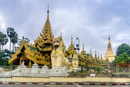 Shwedagon Pagoda (officially named Shwedagon Zedi Daw) and also known as the Great Dagon Pagoda.  A  gilded stupa located in Yangon, Myanmar. Stock Photo