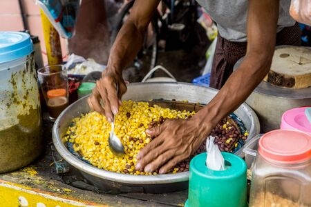 Street food in Yangon, Myanmar - Beans, corn, pepper chutney, lime, salt, and other greens