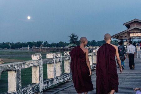 Mandalay, Myanmar - Monks on U Bein Bridge watching for Sunset