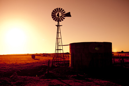 australia farm: Silhouette of a windmill Stock Photo