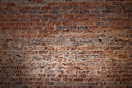 spot: Red brick wall under spotlights.