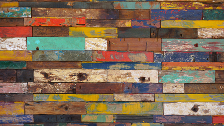 Colorful painted boards on a wall.