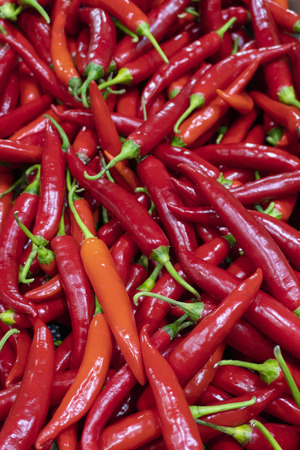 Red chilies at market Standard-Bild - 104383480